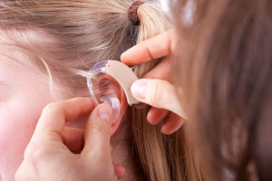 Young girl's hearing aid